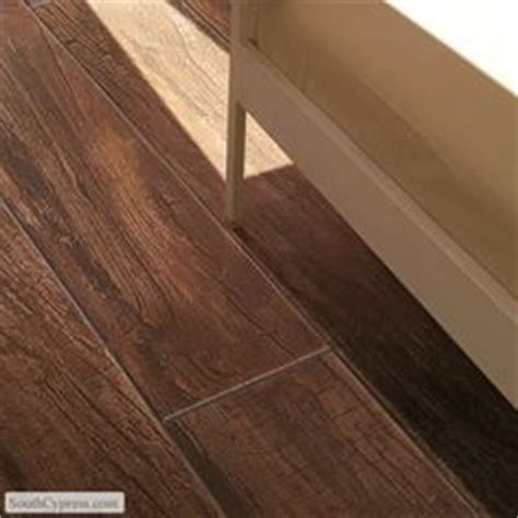 country floors and more happy floors tigerwood papaya wood look porcelain tile