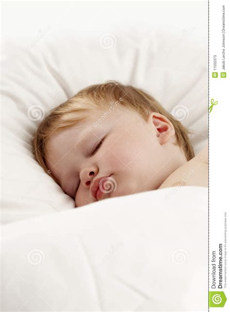 baby sleeping bed baby sleeping in white bed stock photos image 11555373