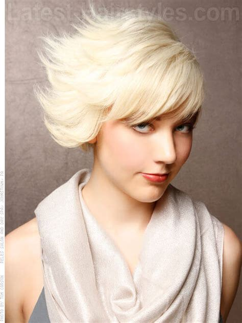 hairstyles with hair behind ears and flipped out bob edgy platinum blonde short haircut