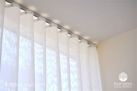 ceiling mount drapery track sheer ripple fold curtain on a white curtain track