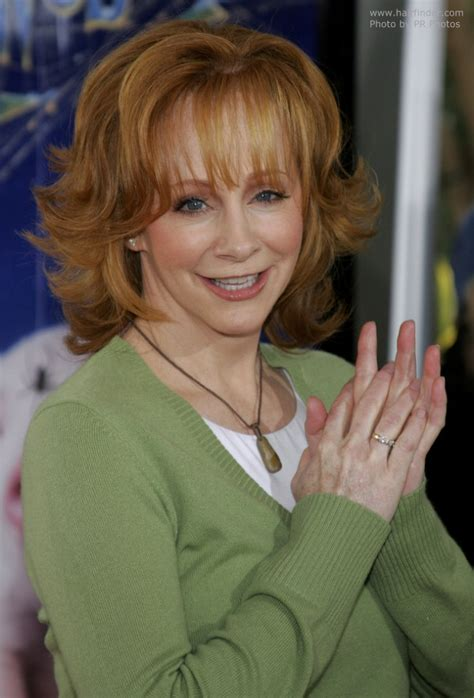 flipped up hairstyles reba mcentire s practical and bouncy red hair with flipped