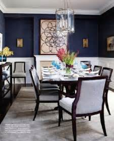 the blue walls for dining the white wainscoting