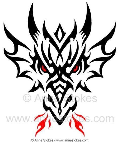 tribal dragon head  anne stokes tattoos pinterest