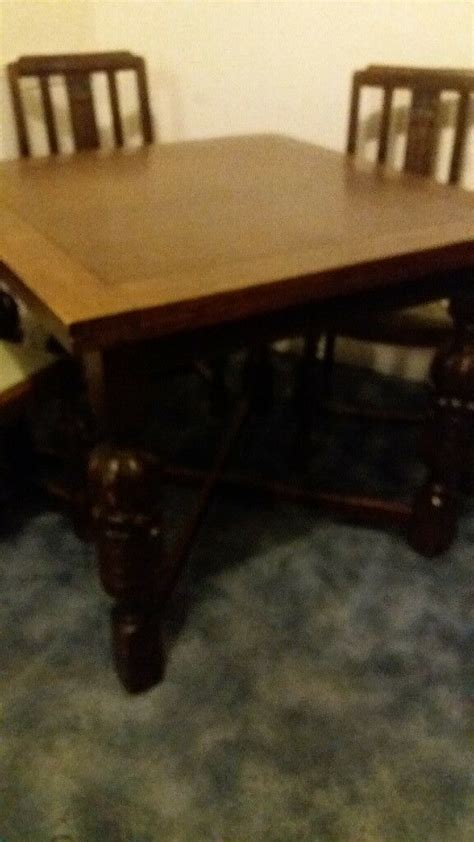antique dining table  matching chairs  sideboard
