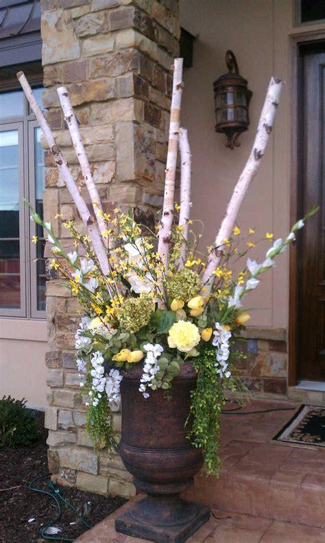 Flower Arrangements For Outside Planters by Urn Arrangement With Birch Poles