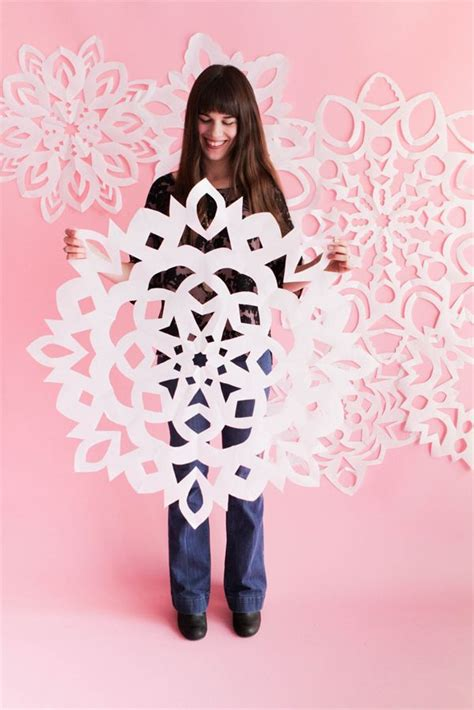 How To Make Big Paper Snowflakes - 25 best ideas about paper snowflakes on paper