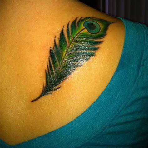 peacock feather tattoo hand peacock feather tattoo tattoos pinterest