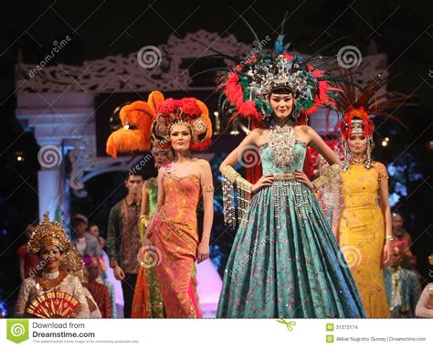 asian female model wearing batik  fashion show runway