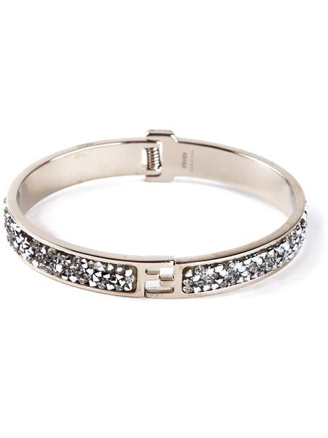 fendi logo rigid bracelet in silver metallic lyst