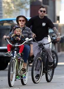 Pink and carey hart enjoy a leisurely bike ride with daughter willow