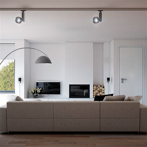 track lighting illuminates a fireplace in a modern living indulgent grey apartment neutral couch minimalist