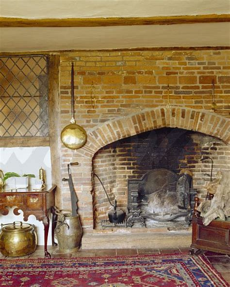 what to do with old fireplace image warming pan on brick fireplace in old country house