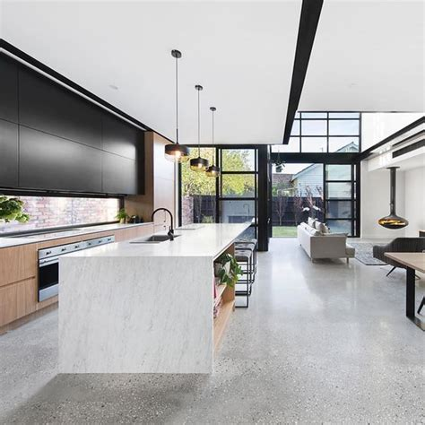 grey polished concrete floor with black and white aggregate black framed windows black and