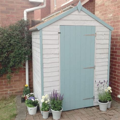 hut inspired garden shed pastel blue house