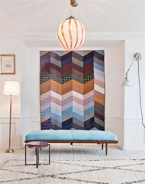 dramatize a focal wall with modern quilt wall hangings