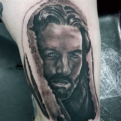 jesus tattoo on his thigh religious style black and white thigh tattoo of jesus