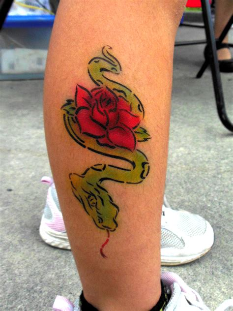 rose tattoo on calf cool snake and airbrush on calf
