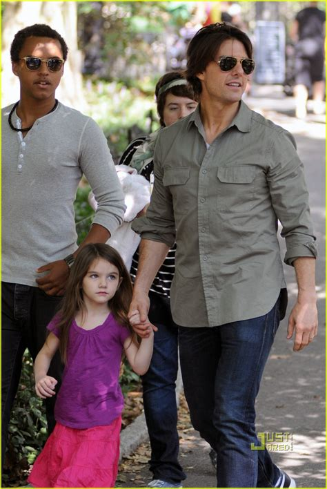 tom and suri cruise win a night at the cinderella castle suite in tom cruise and his kids in central park oh no they didn t