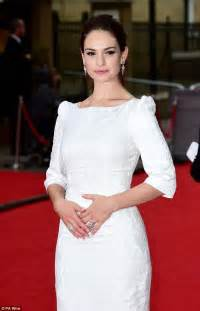 cinderella the actress lily james dons white dress as she leaves downton abbey