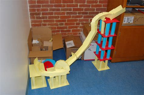 How To Make A Roller Coaster With Paper - physics class paper roller coaster project each team had