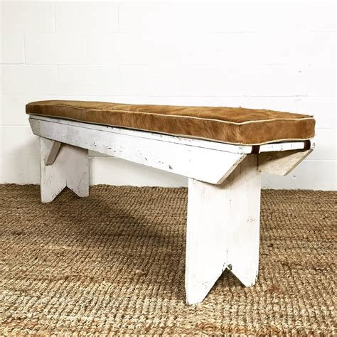 vintage farmhouse bench with palomino cowhide cushion at