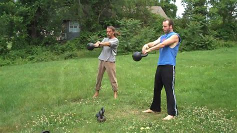 one arm swings kettlebell swing alternating one arm kettlebell swings