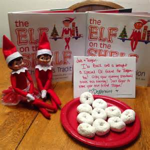 on the shelf with 2 elves building our story