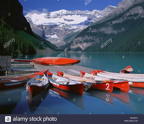 boat tour edmonton banff national park canada red canoes on lake louise with