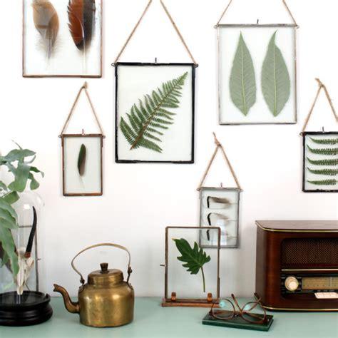 quadros folhas e vidros sobrepostos