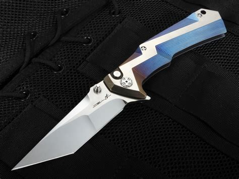 tighe knives brian tighe tighe tac xl blue ano and rwl 34 folding knife