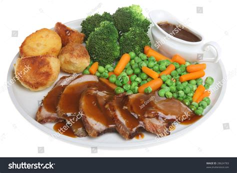 individual gravy boat roast lamb dinner with individual gravy boat stock photo