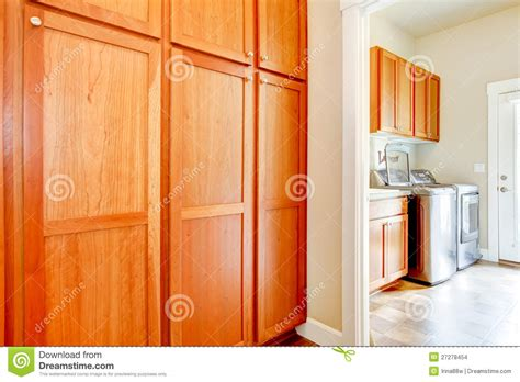 laundry room storage cabinets laundry room with wood storage cabinets stock photo
