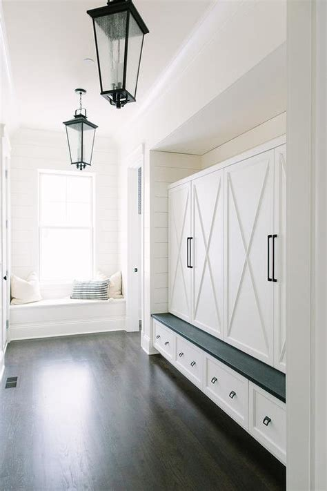 long mudroom  seeded glass lanterns transitional laundry room