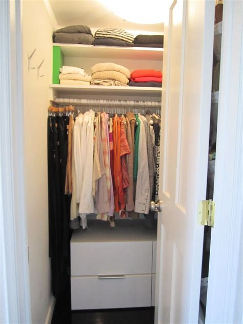 creating closet space in small bedroom white wooden closet plus shelves and hanging space for