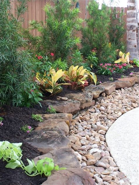 flatten backyard flat rocks with gravel to edge plant beds could do