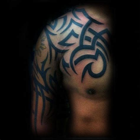tattoo on chest and upper arm 75 tribal arm tattoos for men interwoven line design ideas