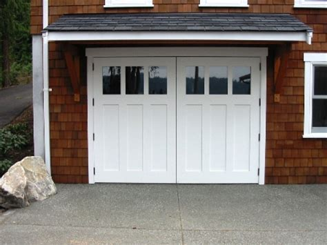 Swing Carriage Garage Doors by Made Custom Wood Garage Doors And Real Carriage House