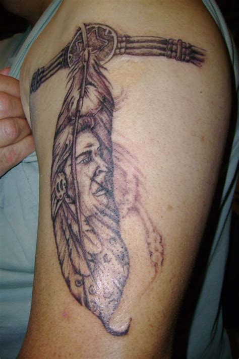 feather tattoo facing up or down indian feather w armband tattoo