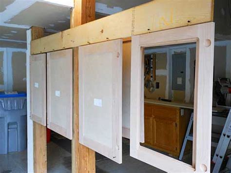how do you hang kitchen wall cabinets how do you hang kitchen wall cabinets ana white 36 quot wall