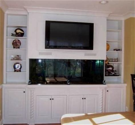 Hand Made Built In Fish Tank Entertainment Center. by Kent