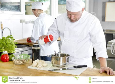 two professional chefs preparing food in large kitchen stock photo image 62465227