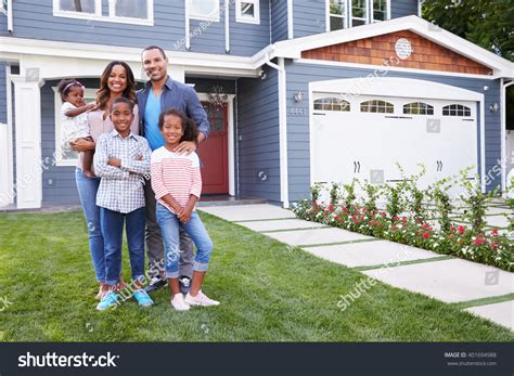 their home happy black family standing outside their stock photo