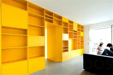 storage walls portuguese apartment with yellow storage wall design milk