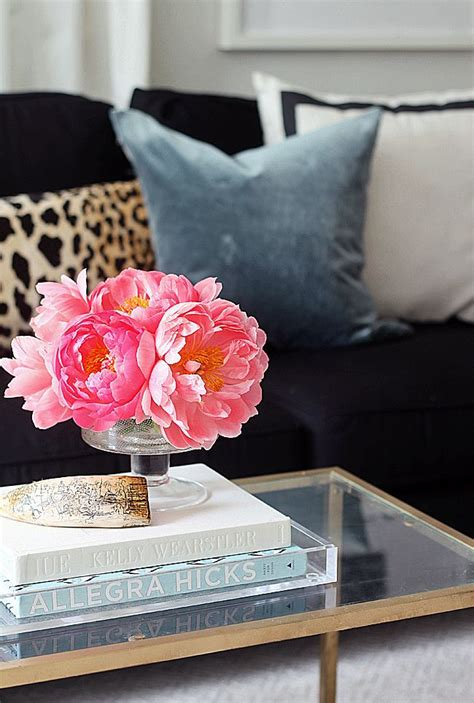 coffee table flower decorations gold and glass mixed with bright fresh flowers is the
