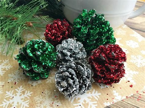 pine cone christmas ideas pine cone crafts pinecone decorations diy glitter pinecones