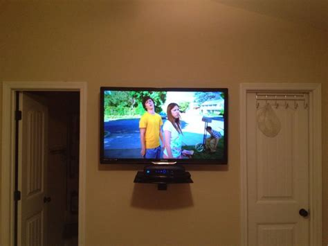 Tv Led Wall led tv wall mount installation with floating glass shelf