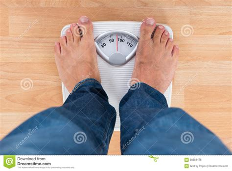 man sections man standing on weighing scale stock photo image 58558476
