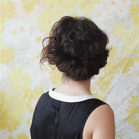 modern tuck and roll hairstyle 18 updos for curly haired girls brit co