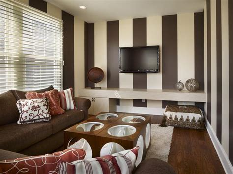 red and brown living room tv room with brown and cream striped walls hgtv
