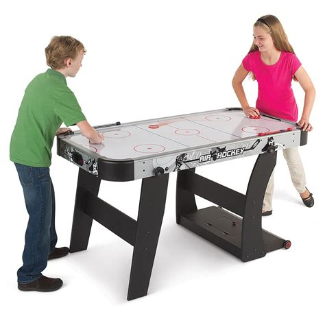 hockey air hockey table the space saving air hockey table hammacher schlemmer